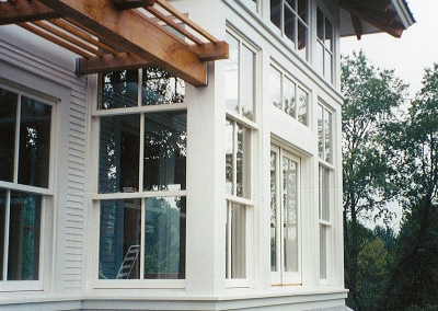 Triple Hung Windows with Motorized Awning Above